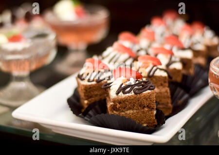 Sweet chocolate cake with strawberry fruit on it - Stock Photo
