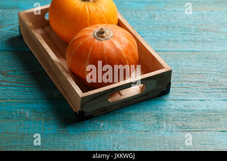 Two pumpkins on wooden table - Stock Photo