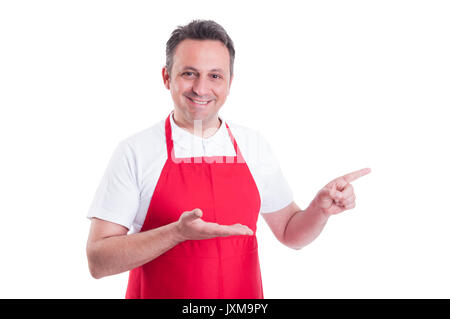 Handsome store employee indicate with finger to the left isolated on white background - Stock Photo