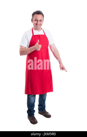 Happy seller pointing down and showing thumb up on white background - Stock Photo