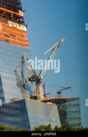 A crane is reflected in a building in the Hudson Yards development in New York on Wednesday August 9, 2017.  (© - Stock Photo