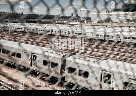 Trains on lay-ups and empty tracks in the Hudson Yards leading into Penn Station on Sunday, August 13, 2017 as Amtrak - Stock Photo