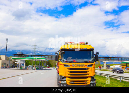 Salzburger Land, Austria - MAY 3, 2017: Yellow Scania truck is parked near the gas station - Stock Photo