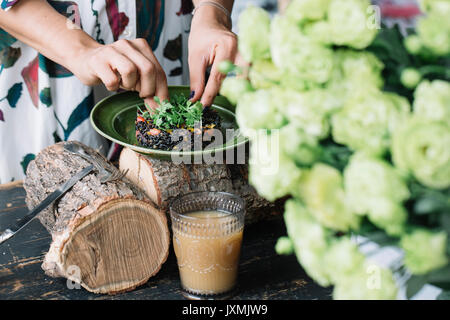 Woman preparing vegetarian dish - Stock Photo