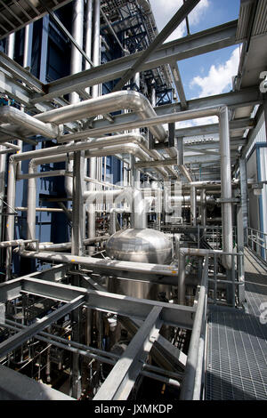 Piping at natural gas fired electric power plant - Stock Photo