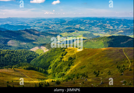 beautiful valley in countryside view from hillside. hilly landscape with meadow and forests under the blue evening - Stock Photo