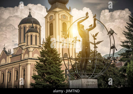 Multicultural Man Builds the World statue and Serbian Orthodox Cathedral, Liberation Square, Sarajevo, Bosnia and - Stock Photo
