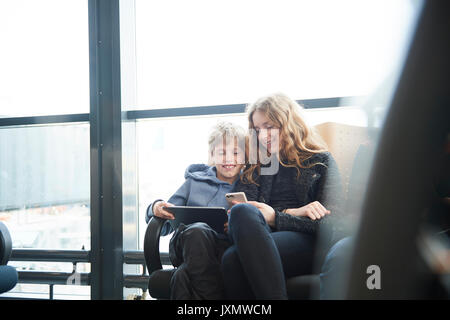 Siblings at airport on way to holiday, Copenhagen, Denmark - Stock Photo