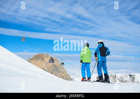 Father and son on skiing holiday, Hintertux, Tirol, Austria - Stock Photo