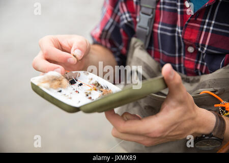 Man preparing bait - Stock Photo