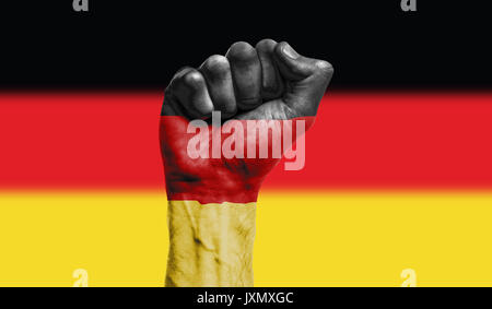 Germany flag painted on a clenched fist. Strength, Power, Protest concept - Stock Photo