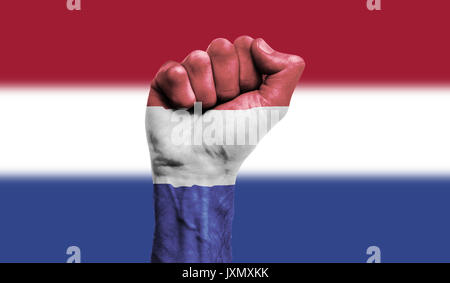 Netherlands flag painted on a clenched fist. Strength, Power, Protest concept - Stock Photo
