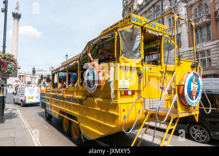 Tourists on the amphibious duck tours bus in Whitehall, London, England. - Stock Photo