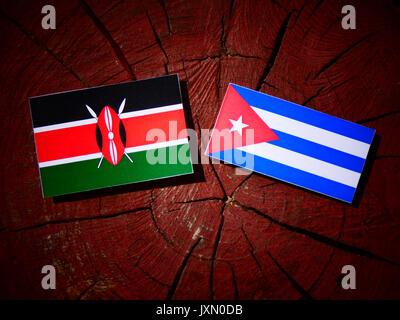Kenyan flag with Cuban flag on a tree stump isolated - Stock Photo