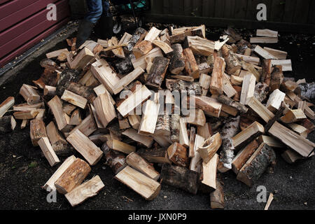 A pile of chopped fire wood logs ready for the cooler months and winter - Stock Photo