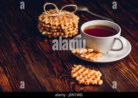 Dessert with White Cup of Tea and Waffle Stack and Waffles Pieces. Copy Space on the Left. - Stock Photo