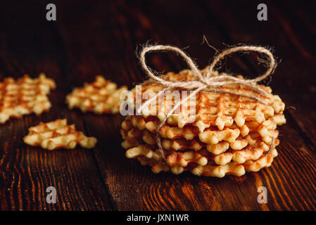 Belgian Waffles Stack with Pieces of Waffle. - Stock Photo