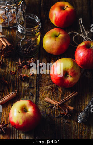 Red Apples with Scattered Clove, Cinnamon and Anise Star. Ingredients for Prepare Mulled Wine. Vertical Orientation. - Stock Photo