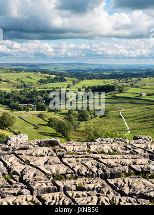 View over Malhamdale from Malham Cove near Malham Yorkshire Dales England - Stock Photo