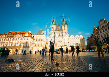 PRAGUE, CZECH REPUBLIC - OCTOBER 15, 2014: Unidentified young woman makes soap bubbles in Old Town Square (Staromestske - Stock Photo
