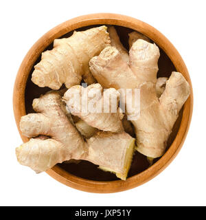 Ginger roots in wooden bowl. Fresh rhizomes of Zingiber officinale, used as a spice or a folk medicine. Isolated - Stock Photo