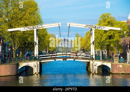 Amsterdam, Netherlands - April 19, 2017: Drawbridge in the capital of the Netherlands, Amsterdam - Stock Photo