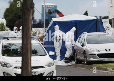 EDITORS NOTE IMAGE PIXELATED BY PA PICTURE DESK Forensics at the scene where man and a woman have been shot dead - Stock Photo
