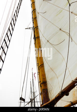 Sails, rigging and wooden mast of a classic schooner. Looking up. - Stock Photo