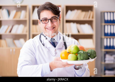 Scientist studying nutrition in various food - Stock Photo