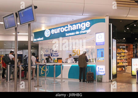 ATHENS, GREECE - May 05: Currency exchange and tax refund counter at Athens International with people waiting in - Stock Photo