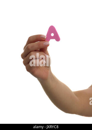 Hand holding foam letter over white background - Stock Photo