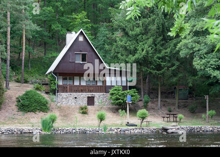 Cottage on the bank of the river Jihlava, Czech Republic in the summer day. - Stock Photo
