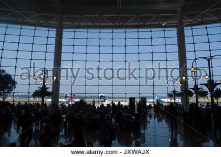 60-foot tall floor to ceiling west-facing structural glass curtain wall in the Central Terminal at SeaTac International - Stock Photo