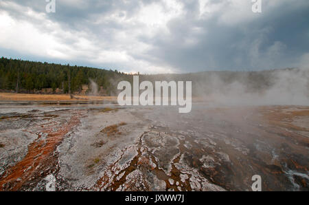 Steam rising off Hot Cascades hot spring in the Lower Geyser Basin in Yellowstone National Park in Wyoming United - Stock Photo