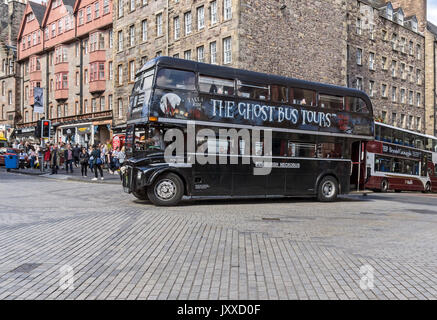 The Ghost Bus Tours bus is turning into Lawnmarket from Bank Street during Edinburgh Festival Fringe 2017 Edinburgh - Stock Photo
