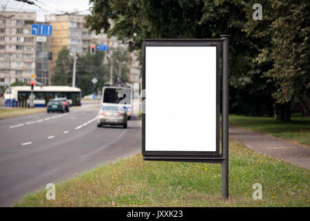 Blank Billboard on City Street. Transport and people in the background - Stock Photo