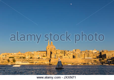 looking from manoel island over marsamxett harbour to valletta with the st. paul's pro-cathedral and basilica of - Stock Photo
