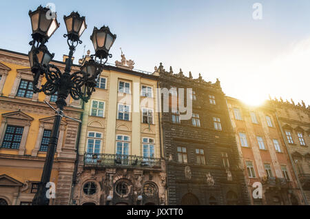 Street of Old town in Lviv. Morning city in the sunlight with sun flare. Ukraine - Stock Photo