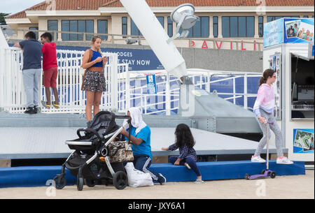 Bournemouth SeaFront and Pier on a beautiful evening. 16th August 2017, people walking around and generally having - Stock Photo