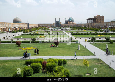 Iran: Naghsh-e Jahan Square (Imam Square or Shah Square) in Isfahan (Ispahan). The Shah Mosque (in the background), - Stock Photo