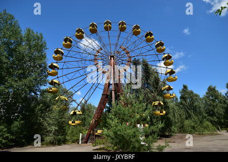Abandoned Fun fair amusement park Chernobyl exclusion zone - Stock Photo