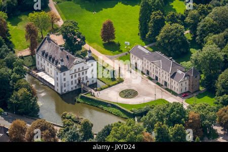 Schloss Borbeck, baroque moated castle, main house and an elongated farm buildings, curly gable, castle park is - Stock Photo