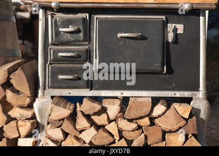 Retro Black Iron Stove with Firewood Front View - Stock Photo
