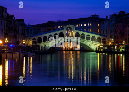 Twilight over the iconic Rialto Bridge spanning the Grand Canal in Venice, Italy. - Stock Photo