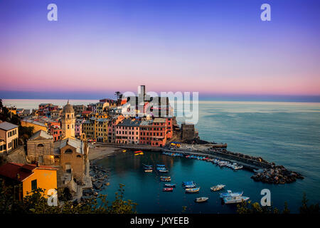 Vernazza at dusk.  This coastal town is one of the five towns of the Cinque Terre and is situated along the Italian - Stock Photo
