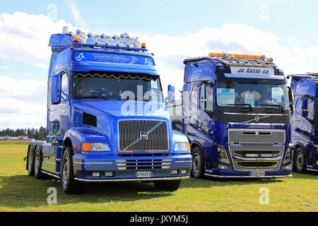 ALAHARMA, FINLAND - AUGUST 11, 2017: Blue conventional Volvo NH12 of Thoden Oy and cab over FH750 of JA Akeri AB - Stock Photo