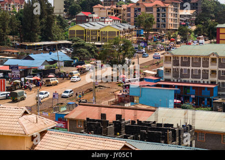 Limuru road busy street scene with people and vehicles, shops and stalls, Ruaka, Kenya - Stock Photo