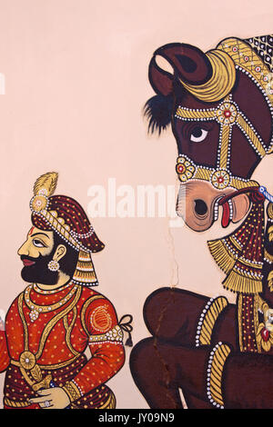 Udaipur, India - March 5, 2015: Detail from wall art in the traditional Rajasthan stye in the City Palace which - Stock Photo