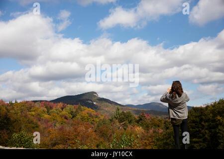 Caucasian woman admiring mountain range in autumn