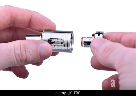 Screwing the coil in sub-ohm tank for e-cig mod - Stock Photo